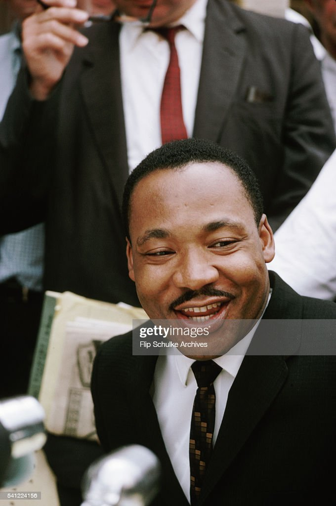 Martin Luther King Jr. speaks to reporters at a press conference for marches protesting bus and restaurant segregation in Birmingham, Alabama.