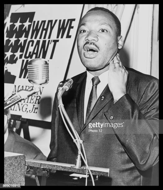 Martin Luther King Jr threequarterlength portrait standing face front at a press conference