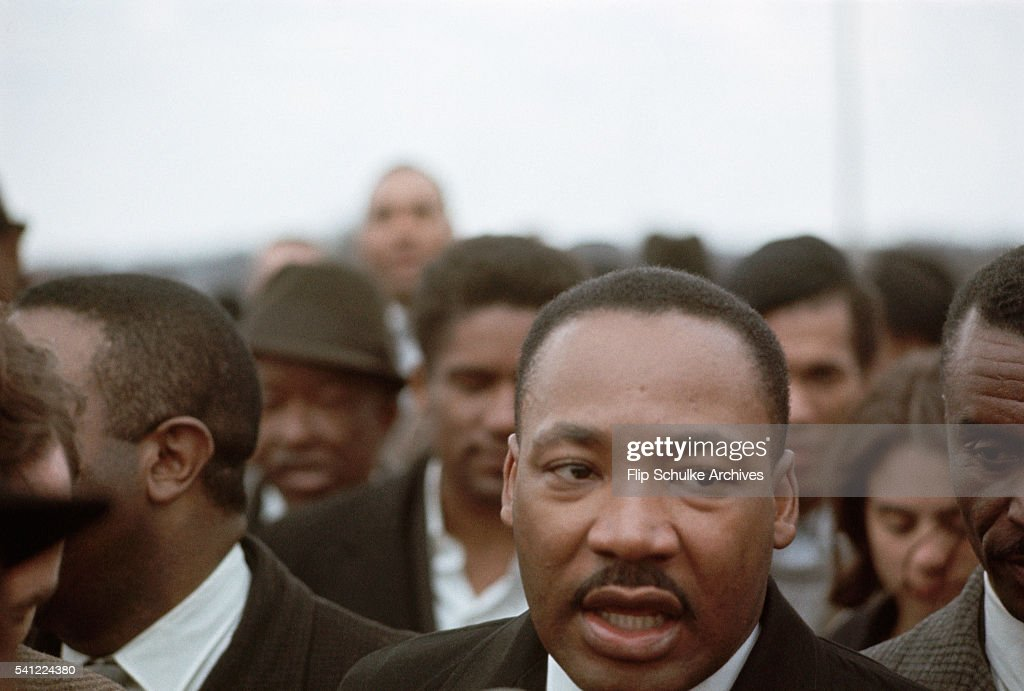 Martin Luther King Jr. walks among the crowd during a march from Selma to Montgomery.