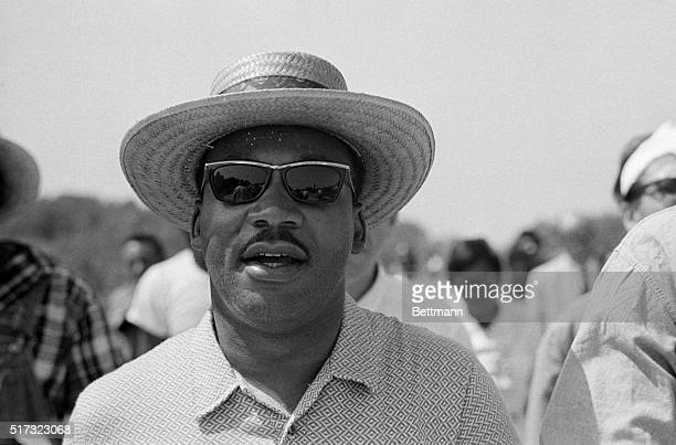 Martin Luther King Jr wearing a hat and sunglasses calls out All right all right we're gonna march we're gonna march straight south as he leads...