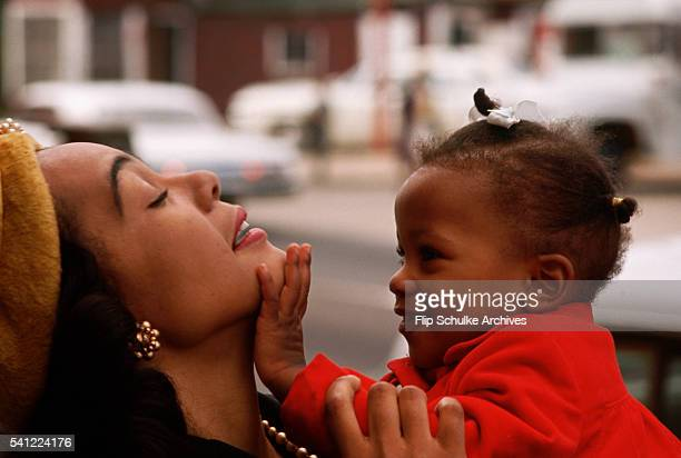 Martin Luther King Jr's wife Coretta Scott King holds and plays with their youngest daughter Bernice outside of Ebenezer Baptist Church
