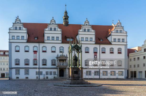 martin luther monument on the market square in lutherstadt wittenberg, germany - lutherstadt wittenberg stock pictures, royalty-free photos & images