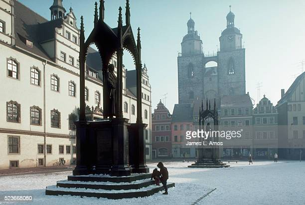 martin luther statue in town square - east germany stock pictures, royalty-free photos & images