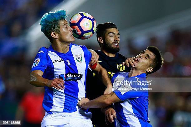 Martin M Mantovani of Deportivo Leganes wins the header after Yannick Carrasco of Atletico de Madrid and Unai Bustinza of Deportivo Leganes during...