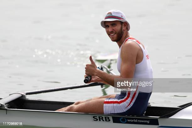 Martin Mackovic of Serbia celebrates towards the camera after the Men's Pair race during Day Four of the 2019 World Rowing Championships on August 28...