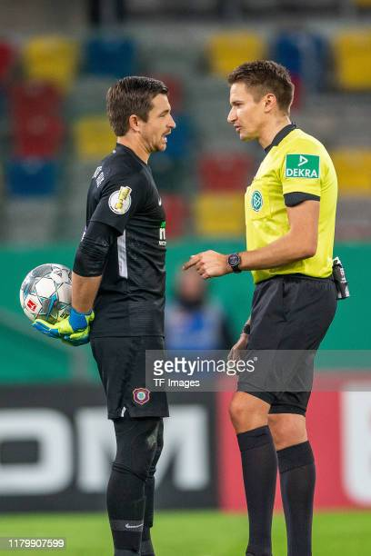 Martin Maennel of Erzgebirge Aue and referee Tobias Reichel discusses during the DFB Cup second round match between Fortuna Duesseldorf and...