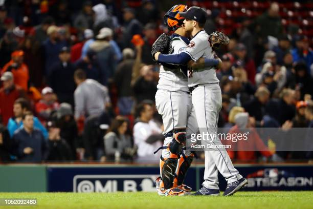 Martin Maldonado and Collin McHugh of the Houston Astros celebrate after the Astros defeated the Boston Red Sox in Game 1 of the ALCS at Fenway Park...