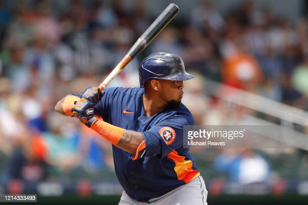 Martin Maldonado of the Houston Astros at bat against the Atlanta Braves during a Grapefruit League spring training game at CoolToday Park on March...