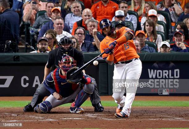 Martin Maldonado of the Houston Astros hits an RBI single against the Atlanta Braves during the second inning in Game Two of the World Series at...