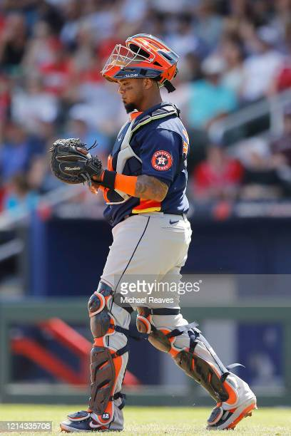 Martin Maldonado of the Houston Astros in action against the Atlanta Braves during a Grapefruit League spring training game at CoolToday Park on...