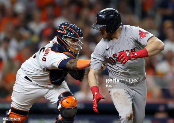 Martin Maldonado of the Houston Astros tags out Christian Arroyo of the Boston Red Sox on a bunt attempt in the sixth inning of Game One of the...