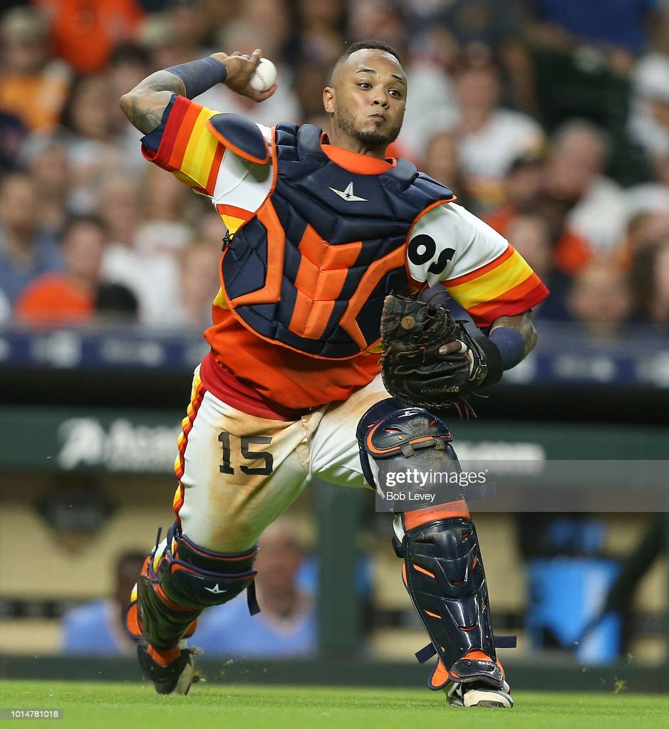 Martin Maldonado #15 of the Houston Astros trows out Dee Gordon #9 of the Seattle Mariners in the eighth inning at Minute Maid Park on August 10, 2018 in Houston, Texas.