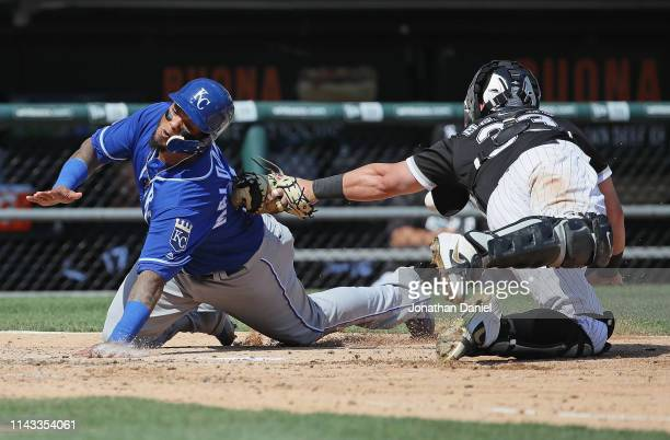 Martin Maldonado of the Kansas City Royals scores a run in the 5th inning as James McCann of the Chicago White Sox drops the ball at Guaranteed Rate...