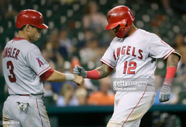 Martin Maldonado of the Los Angeles Angels of Anaheim celebrates with Ian Kinsler of the Los Angeles Angels of Anaheim after hitting a tworun home...