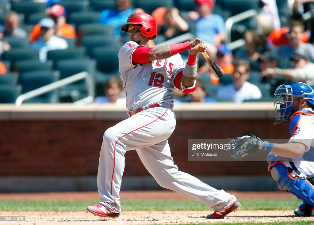 Martin Maldonado #12 of the Los Angeles Angels of Anaheim follows through on a fifth inning single against the New York Mets at Citi Field on May 21, 2017 in the Flushing neighborhood of the Queens borough of New York City.