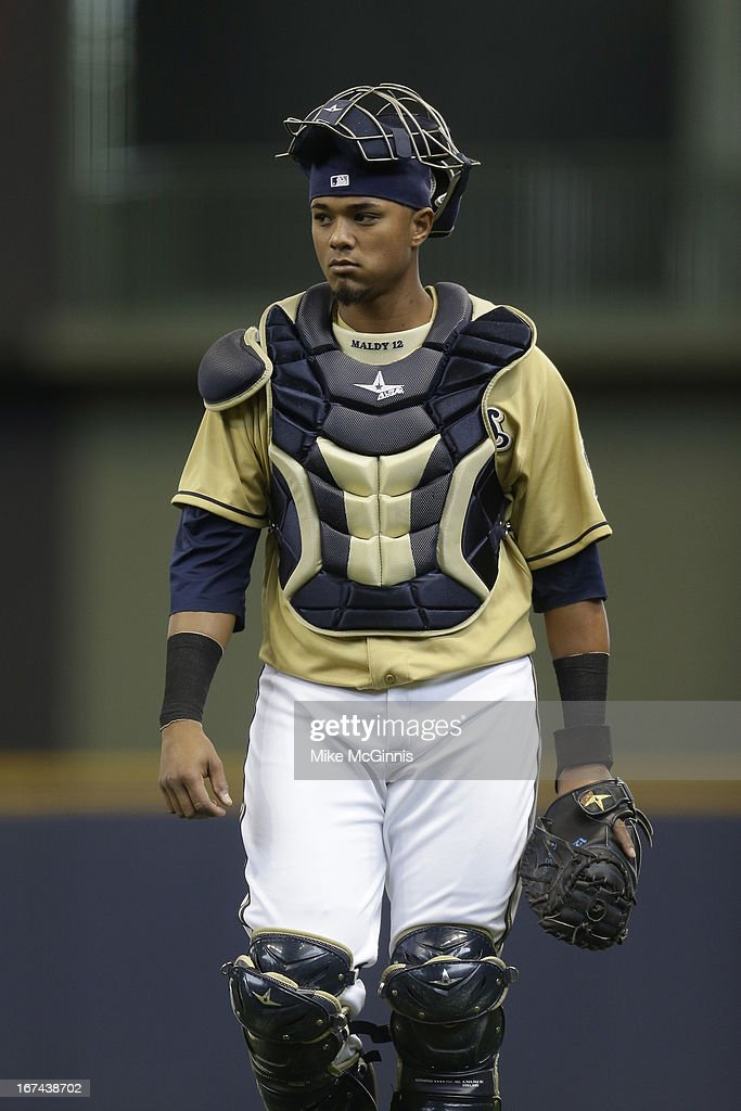 Martin Maldondo #12 of the Milwaukee Brewers walks to the dugout before the game against the Chicago Cubs at Miller Park on April 21, 2013 in Milwaukee, Wisconsin.