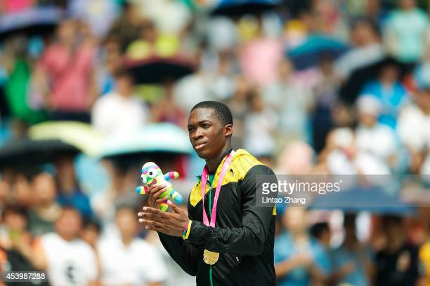 Martin Manley of Jamaica celebrates during the medal ceremony after the Men's 400m Final of Nanjing 2014 Summer Youth Olympic Games at the Nanjing...