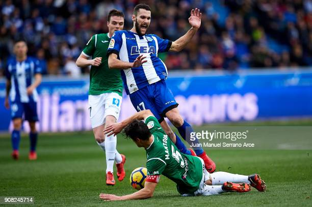 Martin Mantovani of Club Deportivo Leganes duels for the ball with Alfonso Pedraza of Deportivo Alaves during the La Liga match between Deportivo...