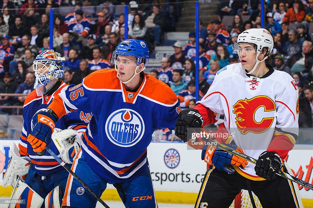 Martin Marincin #85 of the Edmonton Oilers battles for position against Joe Colborne #8 of the Calgary Flames during an NHL game at Rexall Place on December 7, 2013 in Edmonton, Alberta, Canada.
