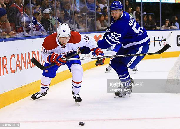 Martin Marincin of the Toronto Maple Leafs and Arturri Lehkonen of the Montreal Canadiens battle for the puck during an NHL preseason game at Air...