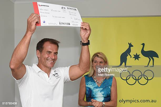 Martin Marinov is presented his QANTAS boarding pass by 2016 Australian Olympic Team Kitty Chiller during the Australian Canoe/KayakSprint 2016...