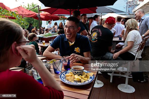 Martin Martinez center from Alexandria laughs while enjoying the company of his friend Kristin as they dine at Pacifico Cantina which opened about 4...