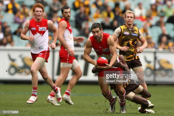 Martin Mattner of the Swans is tackled during the round ten AFL match between the Hawthorn Hawks and the Sydney Swans at Melbourne Cricket Ground on...