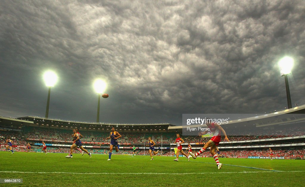 Martin Mattner of the Swans kicks inside 50 as storm clouds gather over the SCG during the round five AFL match between the Sydney Swans and the West Coast Eagles at the Sydney Cricket Ground on April 24, 2010 in Sydney, Australia.