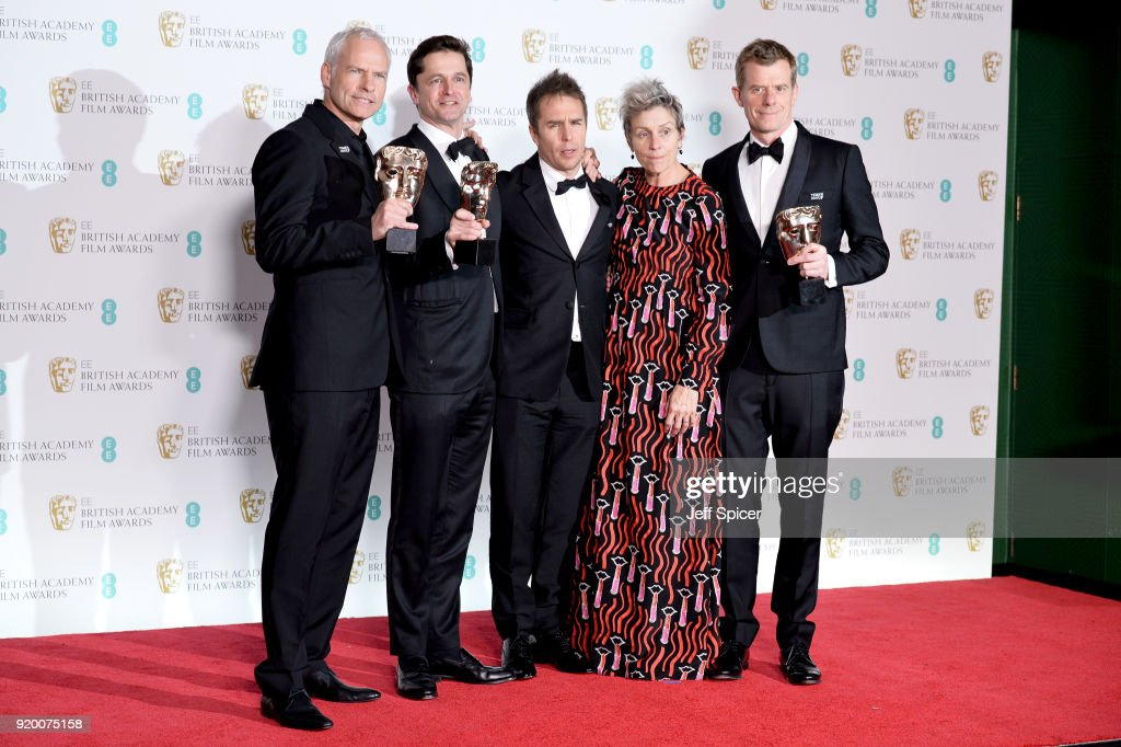 Martin McDonagh (L), Pete Czernin (2ndL) and Graham Broadbent (R), winners of the Outstanding British Film award, Sam Rockwell, winnerof the Best Supporting Actor award and Frances McDormand, winner of the Best Actress award pose in the press room during the EE British Academy Film Awards (BAFTA) held at Royal Albert Hall on February 18, 2018 in London, England.
