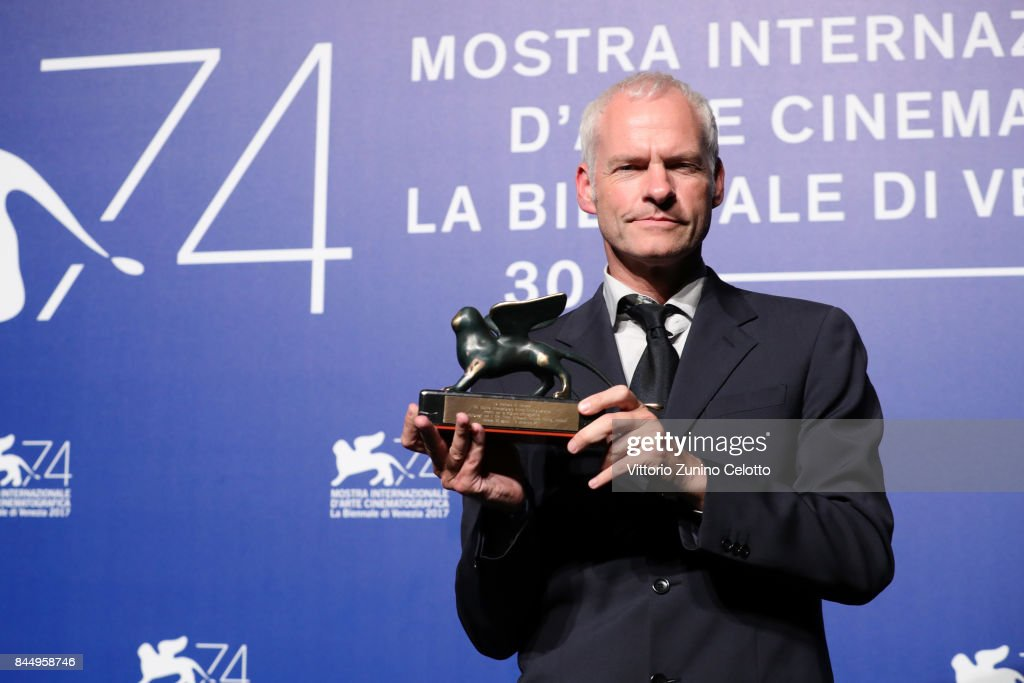 Martin McDonagh poses with the Best Screenplay Award for 'Three Billboards Outside Ebbing, Missouri' at the Award Winners photocall during the 74th Venice Film Festival at Sala Casino on September 9, 2017 in Venice, Italy.