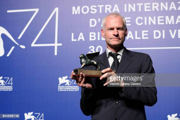 Martin McDonagh poses with the Best Screenplay Award for 'Three Billboards Outside Ebbing Missouri' at the Award Winners photocall during the 74th...