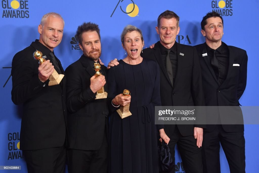 TOPSHOT - Martin McDonagh, Sam Rockwell, Frances McDormand, Graham Broadbent and Peter Czernin pose with the award for Best Motion Picture Drama for 'Three Billboards Outside Ebbing, Missouri' during the 75th Golden Globe Awards on January 7, 2018, in Beverly Hills, California. / AFP PHOTO / Frederic J. BROWN