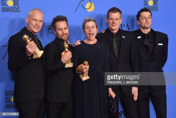 TOPSHOT Martin McDonagh Sam Rockwell Frances McDormand Graham Broadbent and Peter Czernin pose with the award for Best Motion Picture Drama for...