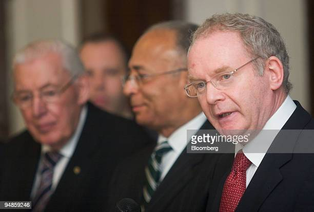 Martin McGuinness, Northern Ireland's deputy first minister, right, speaks as William C. Thompson, New York City comptroller, second right, and Ian...
