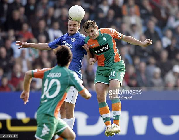 Martin Meichelbeck of Bochum and Miroslav Klose of Bremen go up for a header during the Bundesliga match between VFL Bochum and Werder Bremen at the...