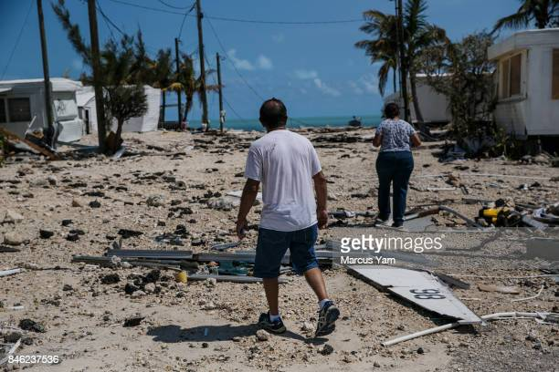 Martin Mendez and Mirta Figueroa walk around the Sea Breeze trailer park to inspect the damage by Hurricane Irma to the homes in Islamorada Florida...