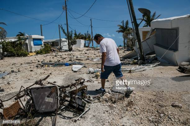 Martin Mendez walks around the Sea Breeze trailer park to inspect the damage by Hurricane Irma to the homes in Islamorada Florida Keys on Sept 12 2017