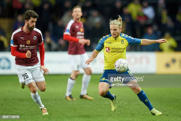 Martin Mikkelsen of Hobro IK and Kasper Fisker of Brondby IF compete for the ball during the Danish Alka Superliga match between Brondby IF and Hobro...