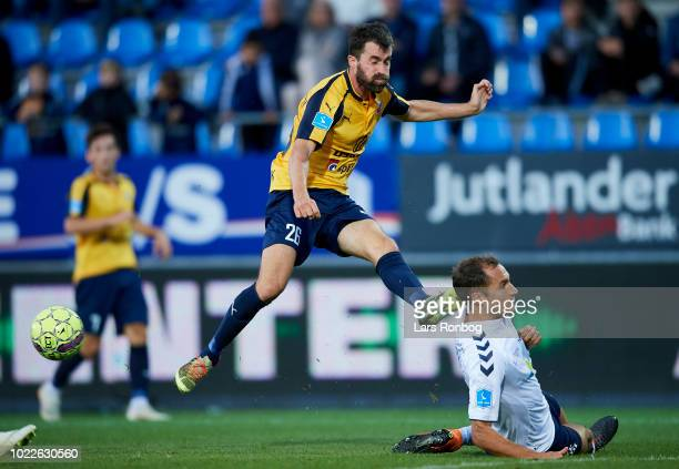 Martin Mikkelsen of Hobro IK and Niklas Backman of AGF Aarhus compete for the ball during the Danish Superliga match between Hobro IK and AGF Aarhus...