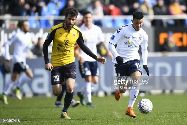 Martin Mikkelsen of Hobro IK and Tobias Sana of AGF Aarhus compete for the ball during the Danish Alka Superliga match between Hobro IK and AGF...