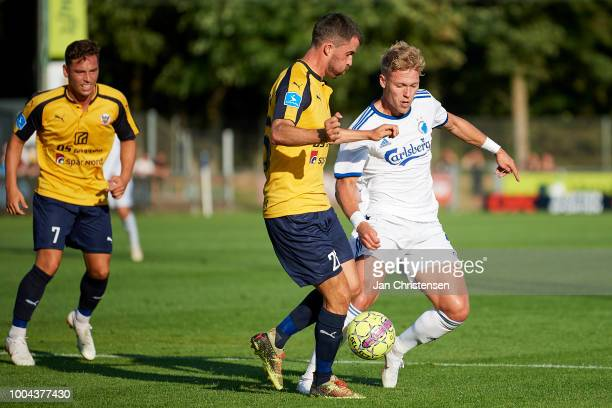 Martin Mikkelsen of Hobro IK and Viktor Fischer of FC Copenhagen compete for the ball during the Danish Superliga match between Hobro IK and FC...