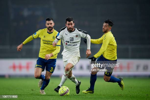 Martin Mikkelsen of Hobro IK Anthony Jung of Brondby IF and Besar Halimi of Brondby IF compete for the ball duringthe Danish Superliga match between...
