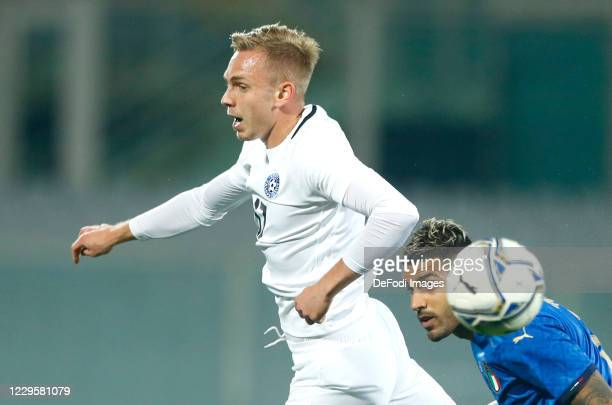 Martin Miller of Estonia and Emerson Palmieri of Italy battle for the ball during the International Friendly match between Italy and Estonia at...