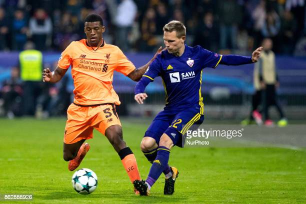 Martin Miller of NK Maribor competes with Georginio Wijnaldum of Liverpool FC during the UEFA Champions League match between NK Maribor and Liverpool...