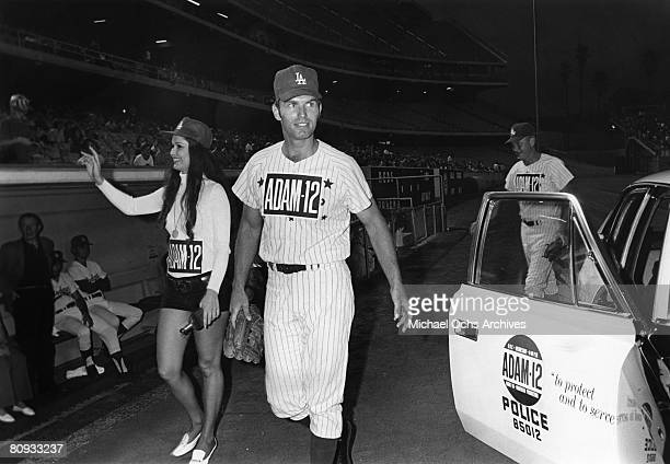 Martin Milner and Kent McCord costars of the hit 1970's TV show Adam 12 head for the dugout before a charity baseball game against real cops on...