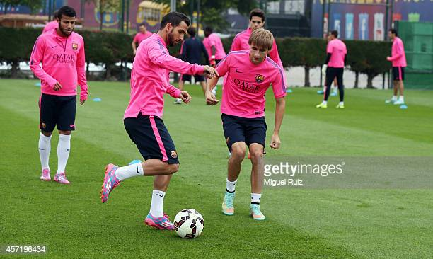 Martin Montoya and Sergi Samper in action during the FC Barcelona training session at Ciutat Esportiva on October 14 2014 in Barcelona Spain