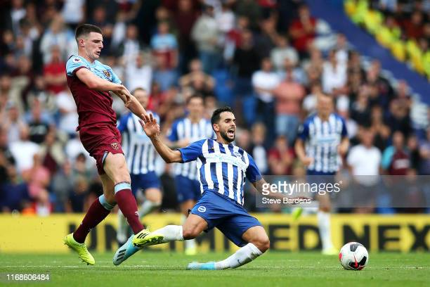 Martin Montoya of Brighton and Hove Albion is brought down by Declan Rice of West Ham United during the Premier League match between Brighton Hove...