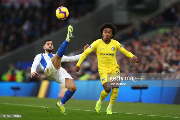 Martin Montoya of Brighton and Hove Albion stretches for the ball under pressure from Willian of Chelsea during the Premier League match between...