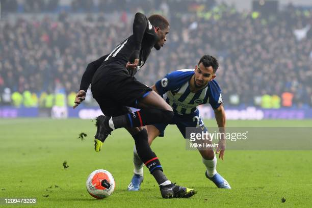 Martin Montoya of Brighton Hove Albion challenges Wilfried Zaha of Crystal Palace during the Premier League match between Brighton Hove Albion and...