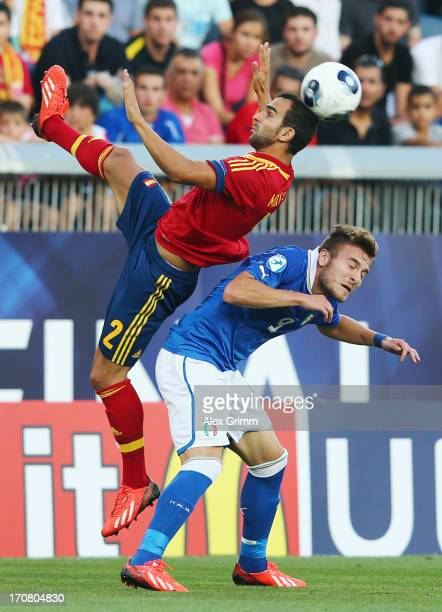 Martin Montoya of Spain outjumps Ciro Immobile of Italy during the UEFA European U21 Championship final match between Italy and Spain at Teddy...